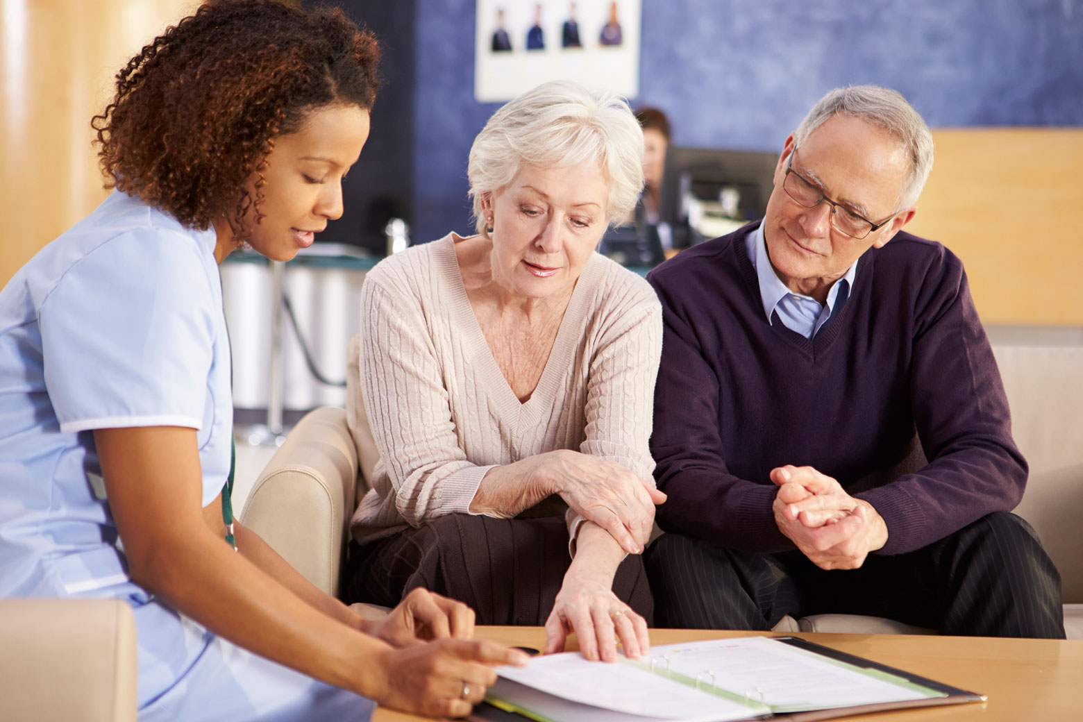 Older adults looking at life care planning documents with elder law professional